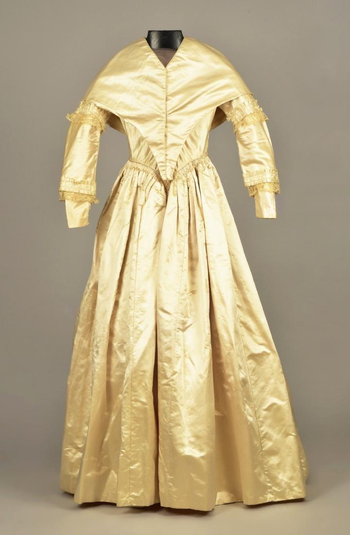 CREAM SATIN WEDDING DRESS and CAPE, c. 1845