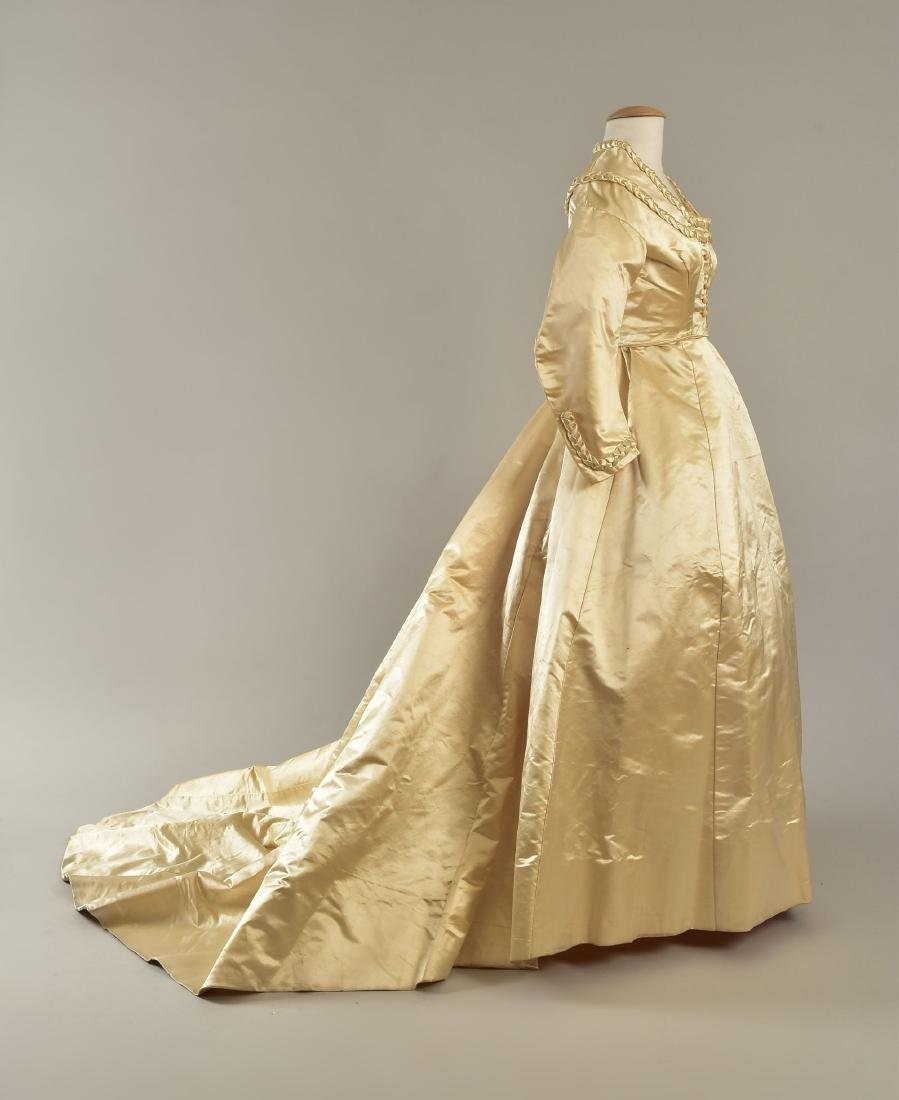 TRAINED SATIN WEDDING GOWN with BRAIDED TRIM, 1867