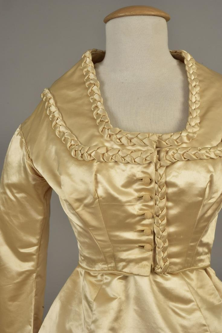 TRAINED SATIN WEDDING GOWN with BRAIDED TRIM, 1867 - 2