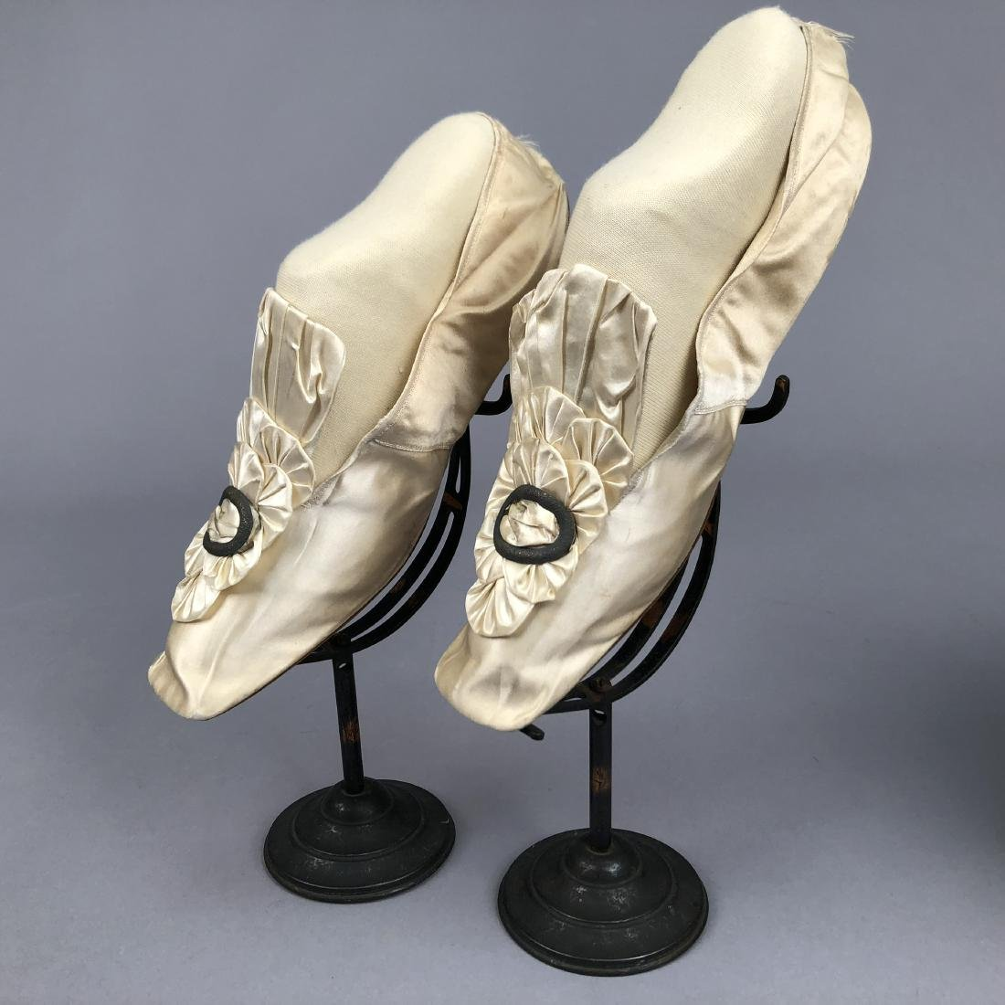 TWO PAIR CREAM FLATS with SILK DECORATION, 1840s and - 2