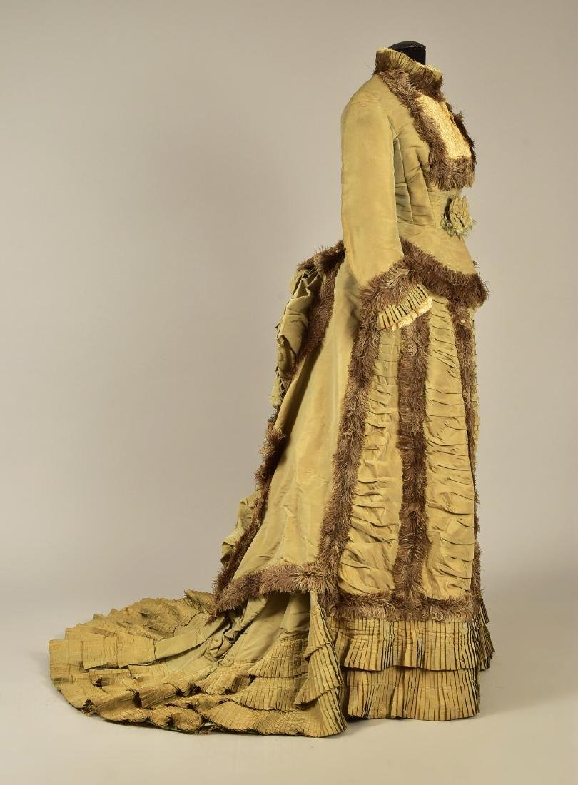 OSTRICH FEATHER-TRIMMED BUSTLE GOWN, 1876