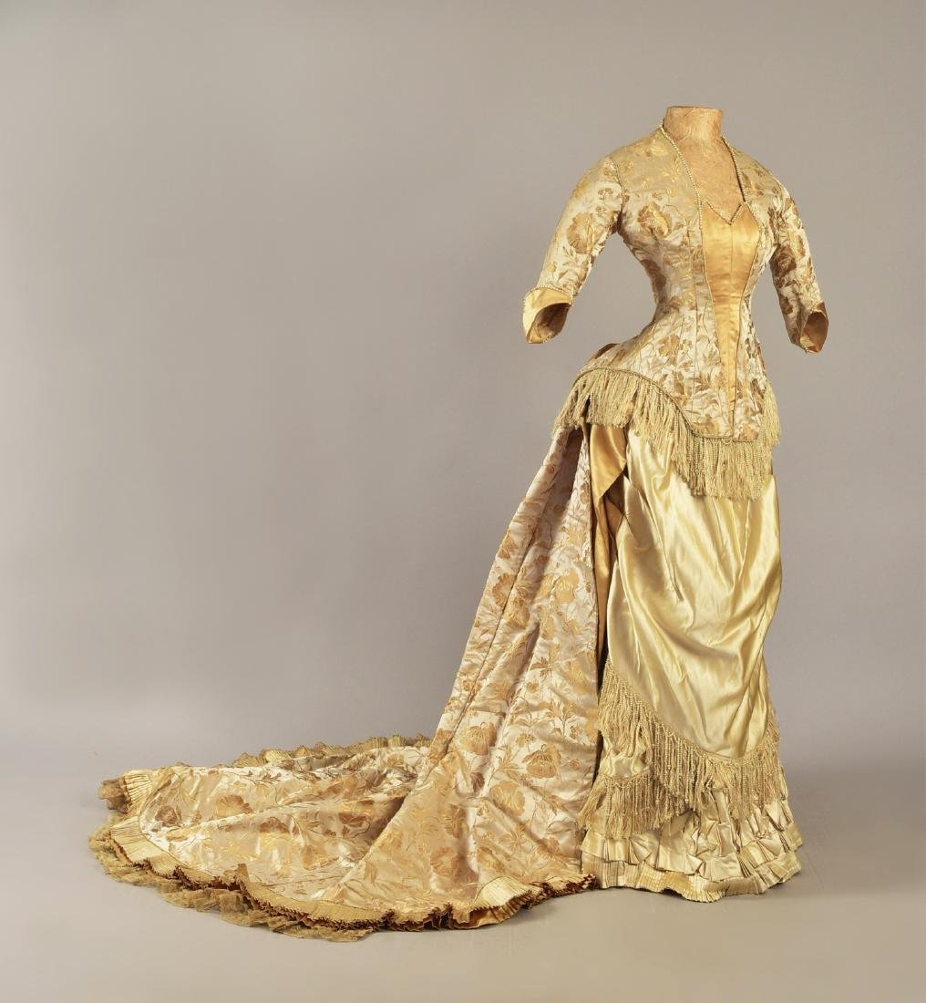 FRINGED and PEARL-TRIMMED SILK BUSTLE GOWN, c. 1879
