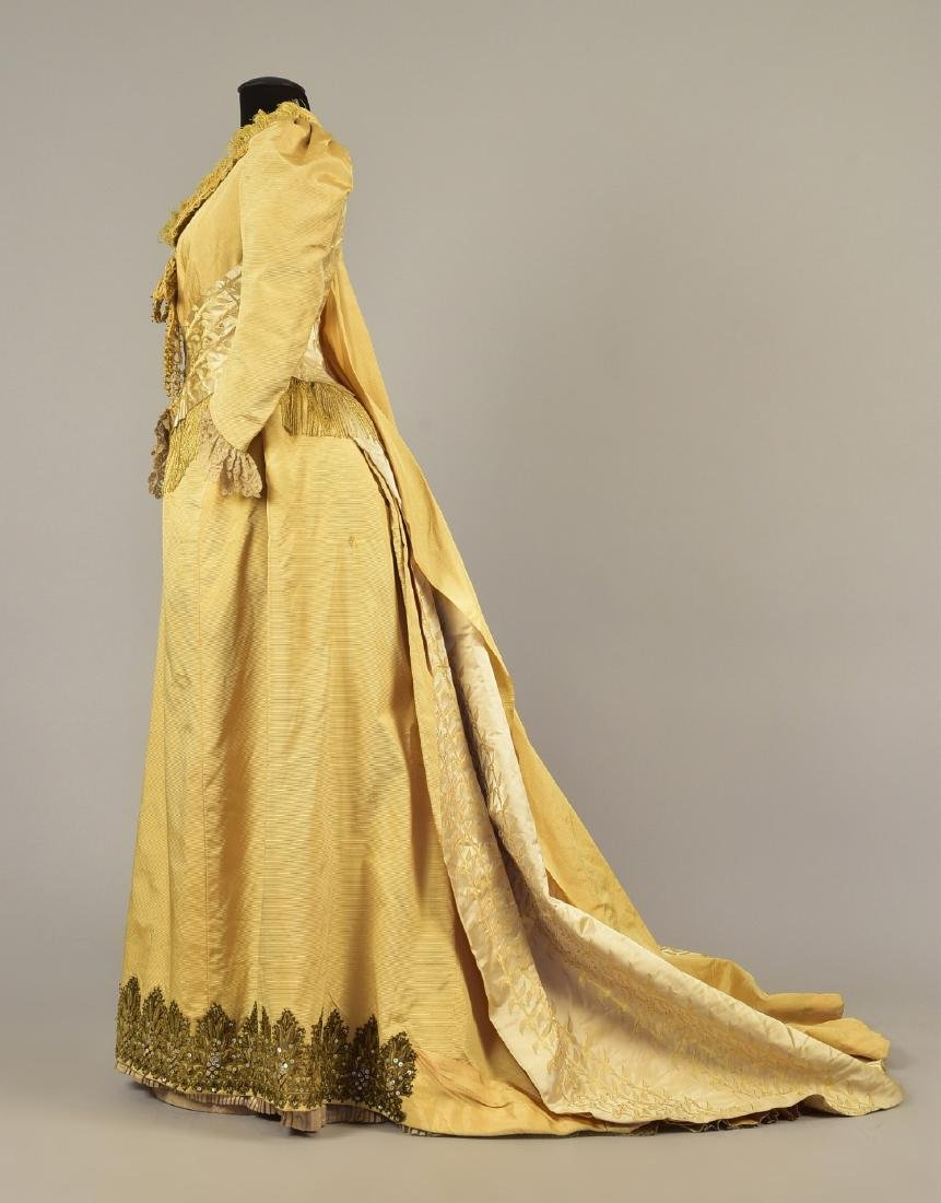 TRAINED SILK BUSTLE GOWN, c. 1887
