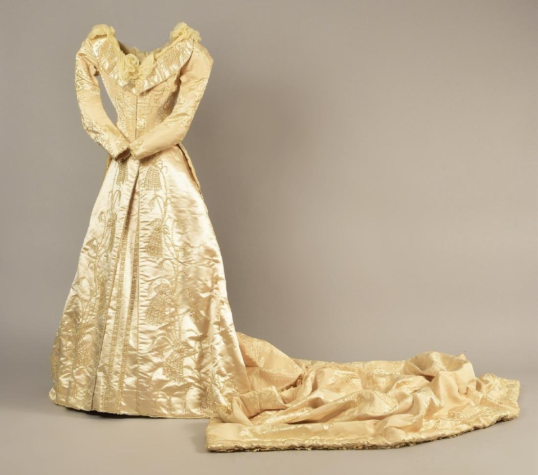 LONDON TRAINED WEDDING GOWN and ACCESSORIES, c. 1890