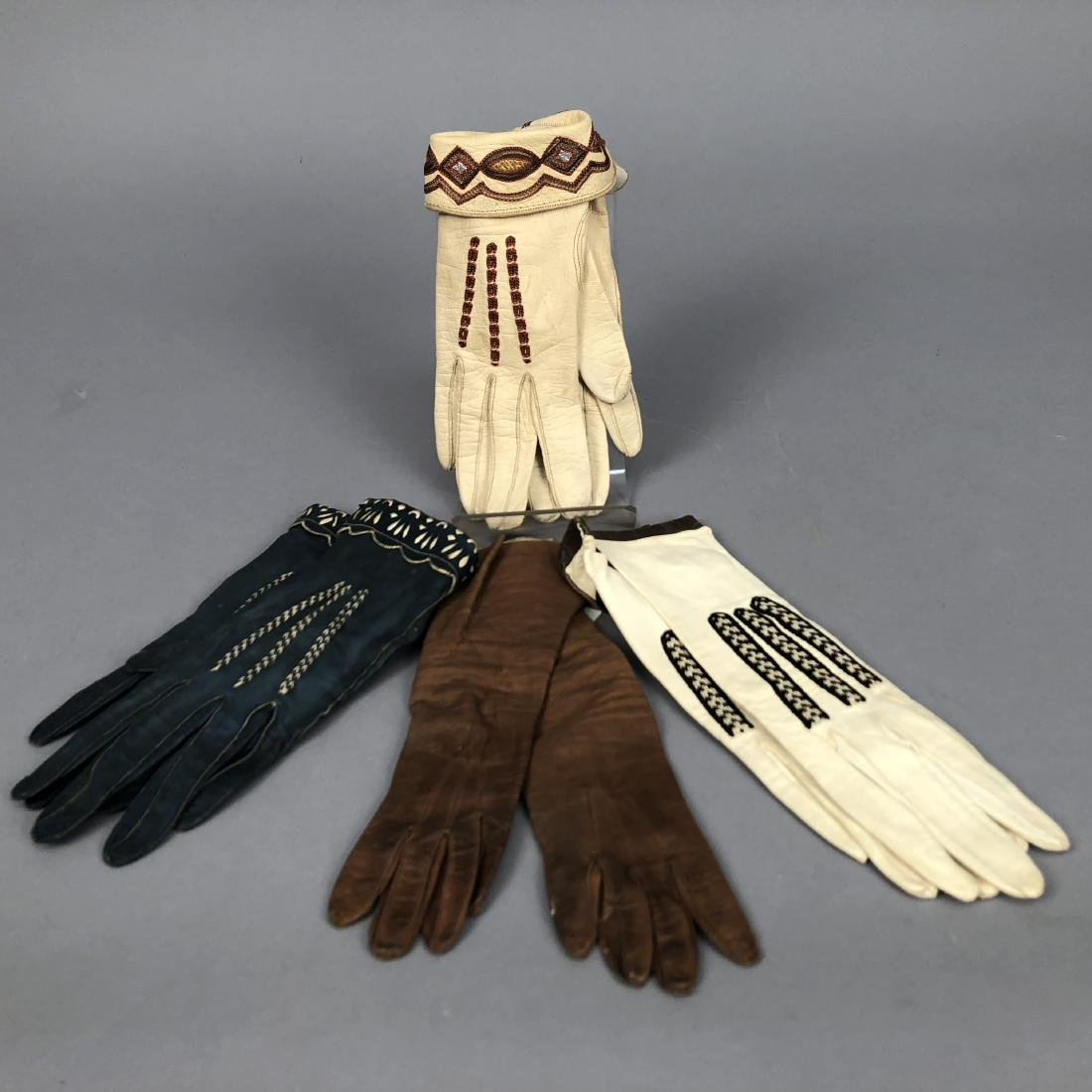 THREE PAIR DECORATED LEATHER GLOVES, c. 1920