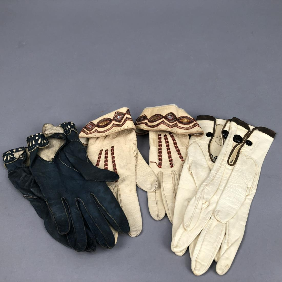 THREE PAIR DECORATED LEATHER GLOVES, c. 1920 - 2