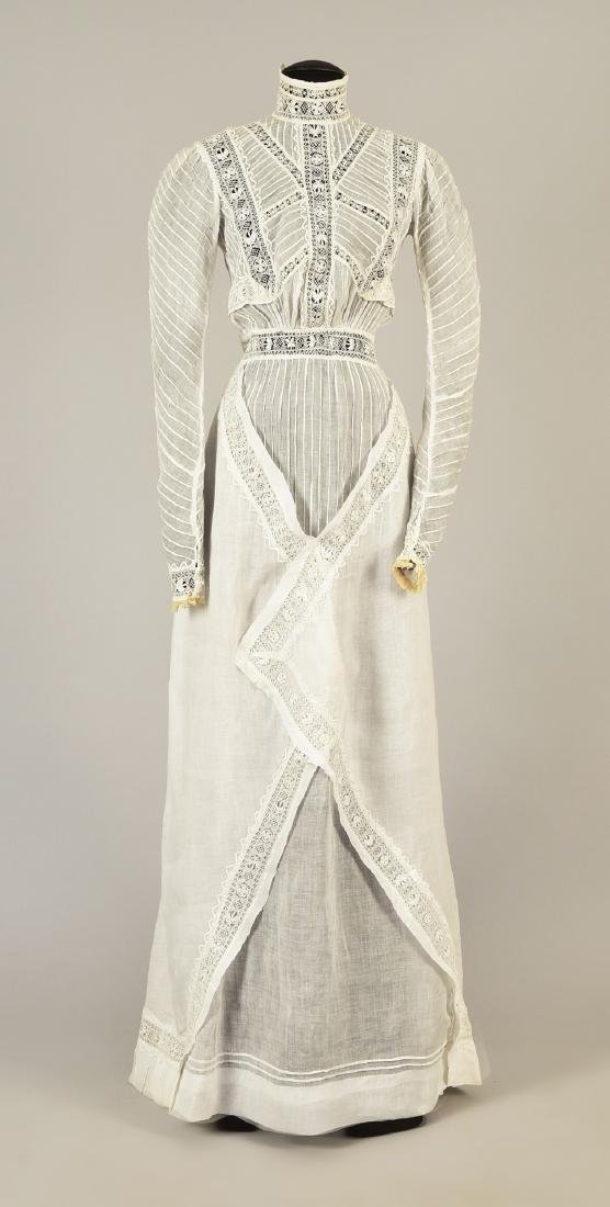 TALL LADY'S WHITE COTTON HIGH-NECK GOWN, c. 1910
