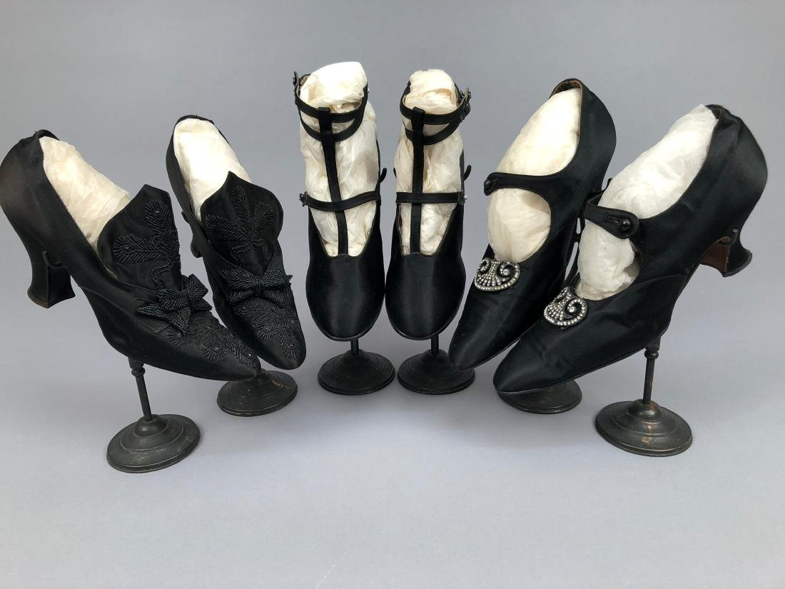 THREE PAIR HEELED BLACK SATIN SHOES, 1912 - 1915