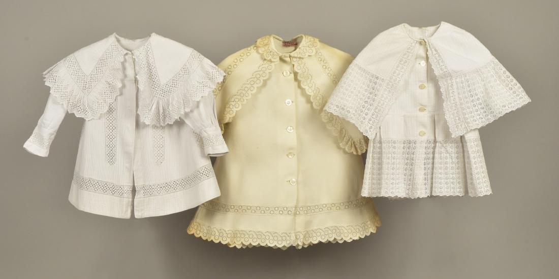 THREE CHILDREN'S WHITE COTTON COATS, c. 1900