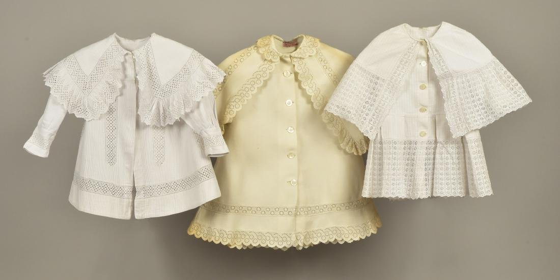 THREE CHILDREN'S WHITE COTTON COATS, c. 1900