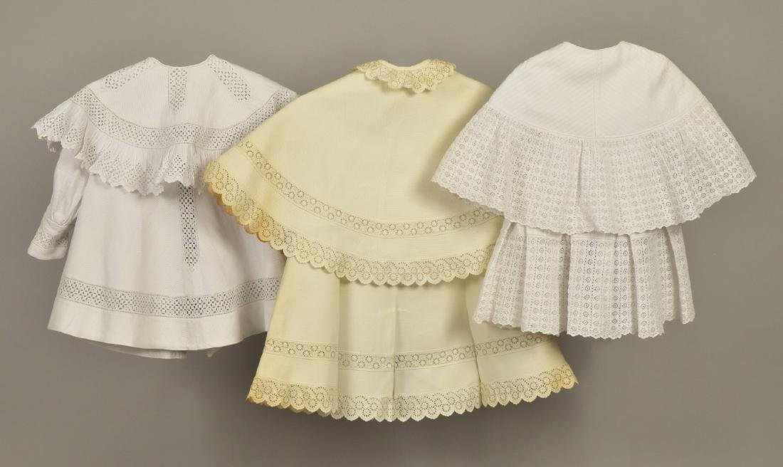 THREE CHILDREN'S WHITE COTTON COATS, c. 1900 - 2