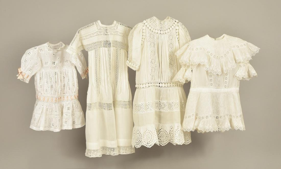 FOUR CHILDREN'S WHITE COTTON DRESSES, EARLY 20th C