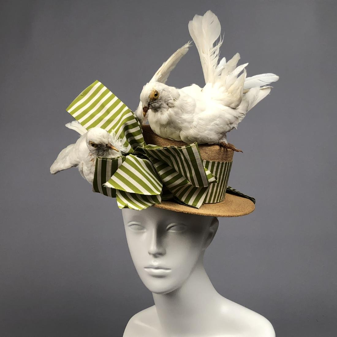 STRAW HAT TRIMMED with WHITE PIGEONS, EARLY 20th C