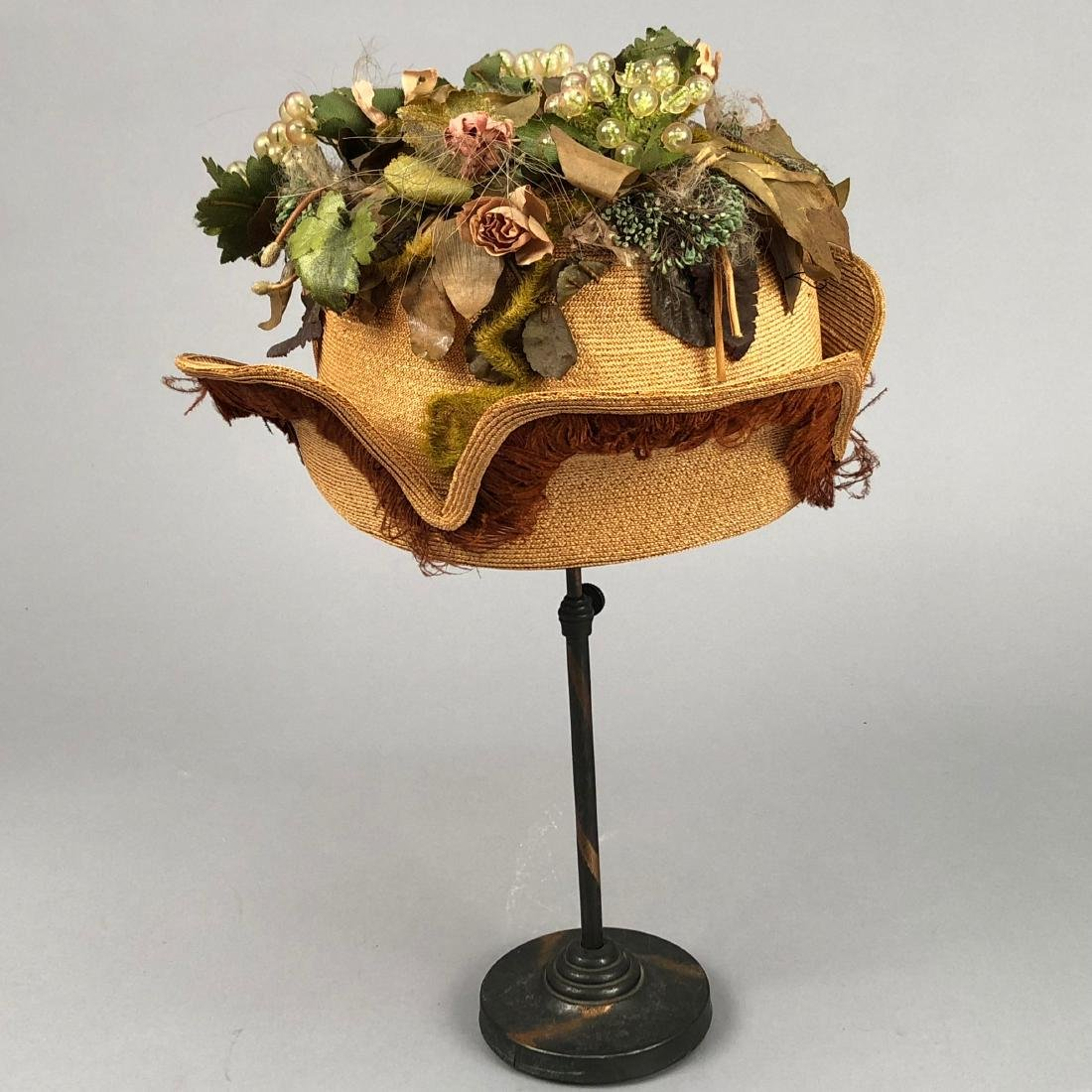 STRAW HAT with NOTCHED BRIM and GRAPE DECORATION, c.