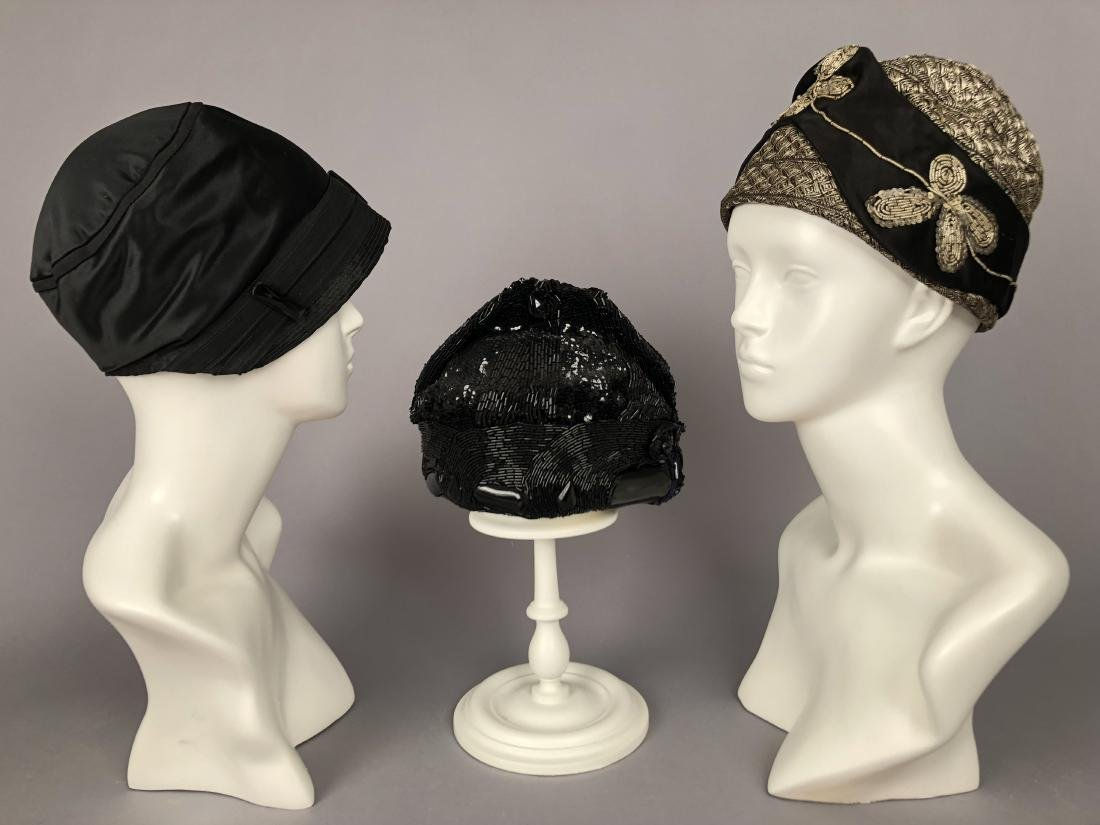 THREE BLACK SILK CLOCHES, 1920s