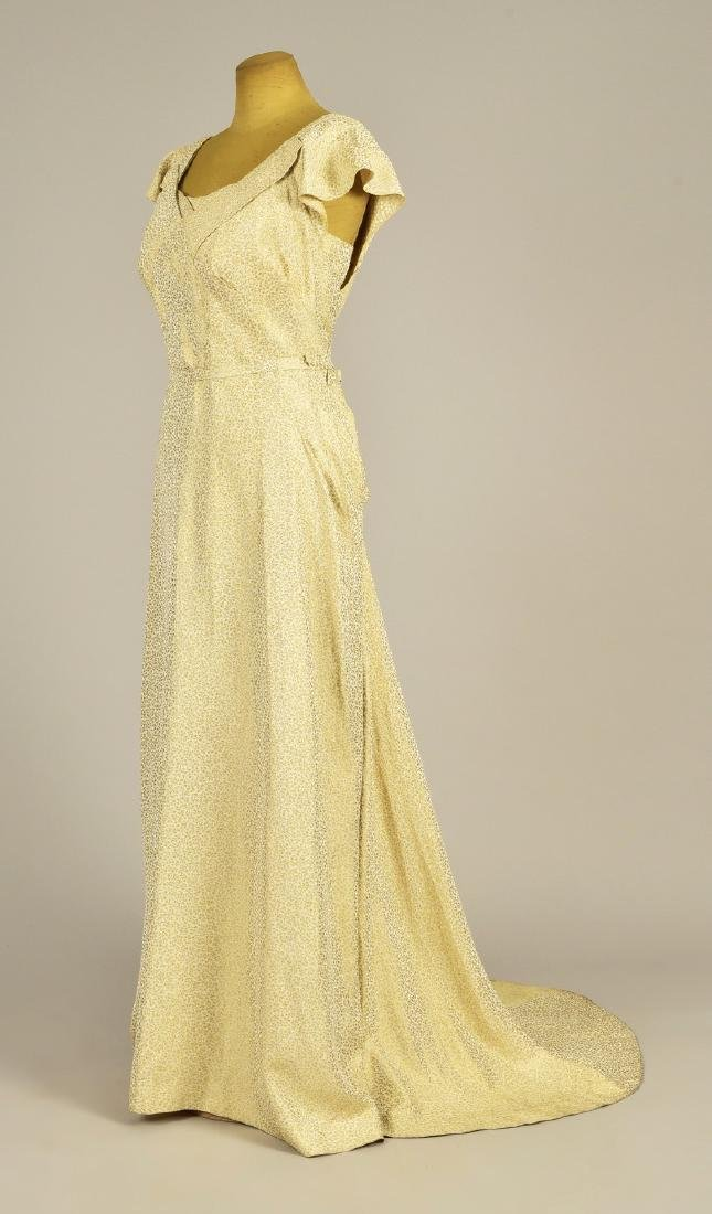 ENGLISH TRAINED CREAM and GOLD EVENING GOWN, 1937