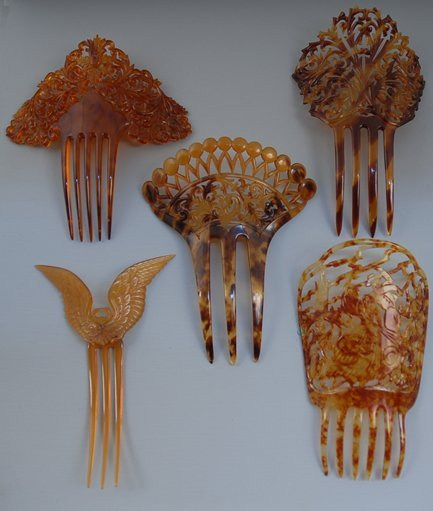 15: FOUR FAUX TORTOISE PIERCED CELLULOID HAIR COMBS and