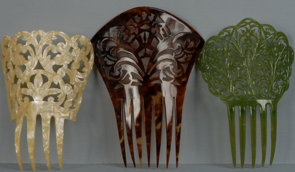 25: THREE LARGE PIERCED CELLULOID HAIR COMBS, 1890-1920