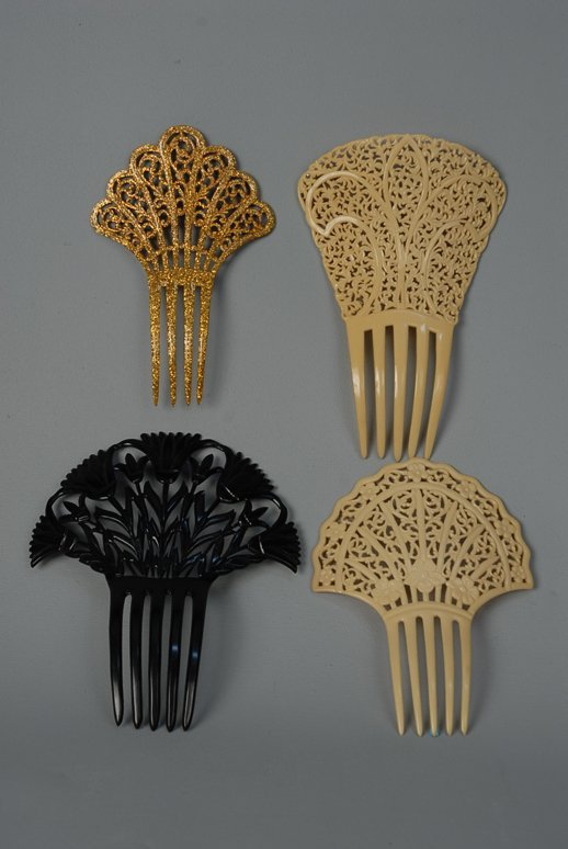28: FOUR CELLULOID HAIR COMBS, 1890-1920. Two finely pi