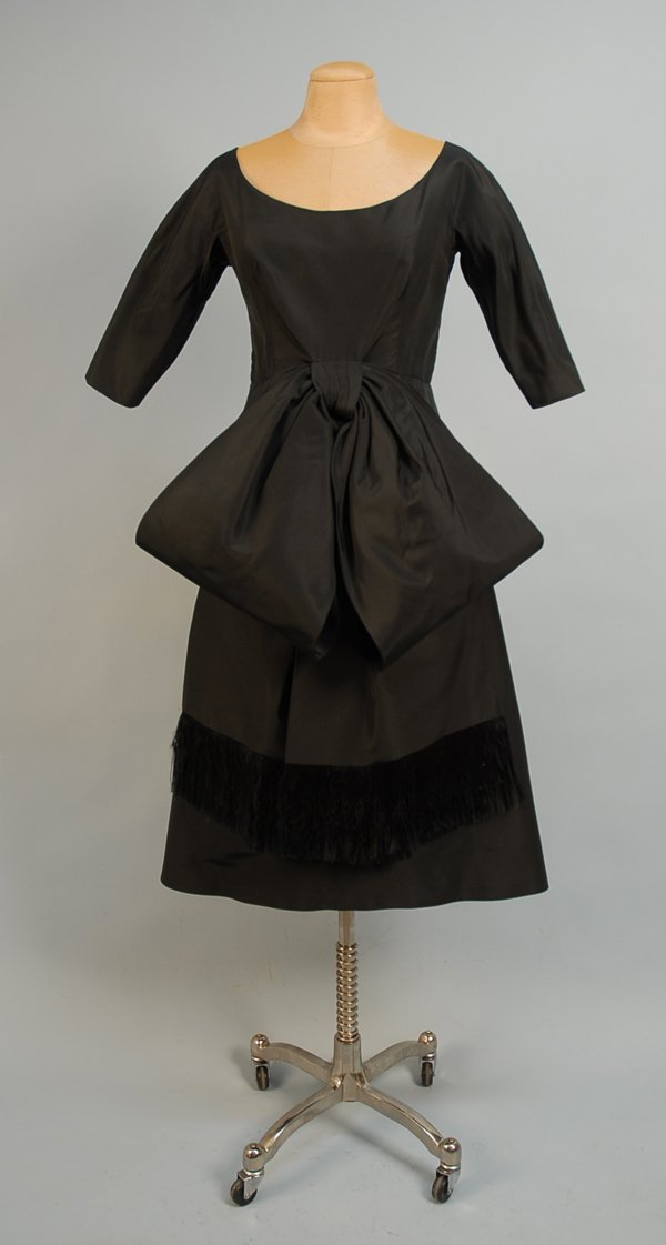 527: BLACK SILK COCKTAIL DRESS WITH BOW, MID 20th C Ful