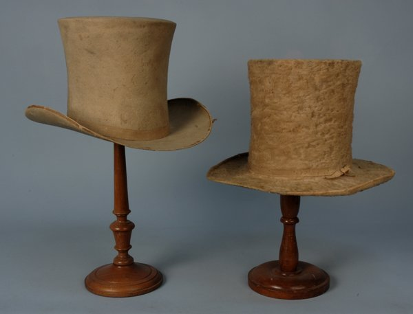 590: TWO GENT'S HATS, 1825-1840 & 1860s Both white fur: