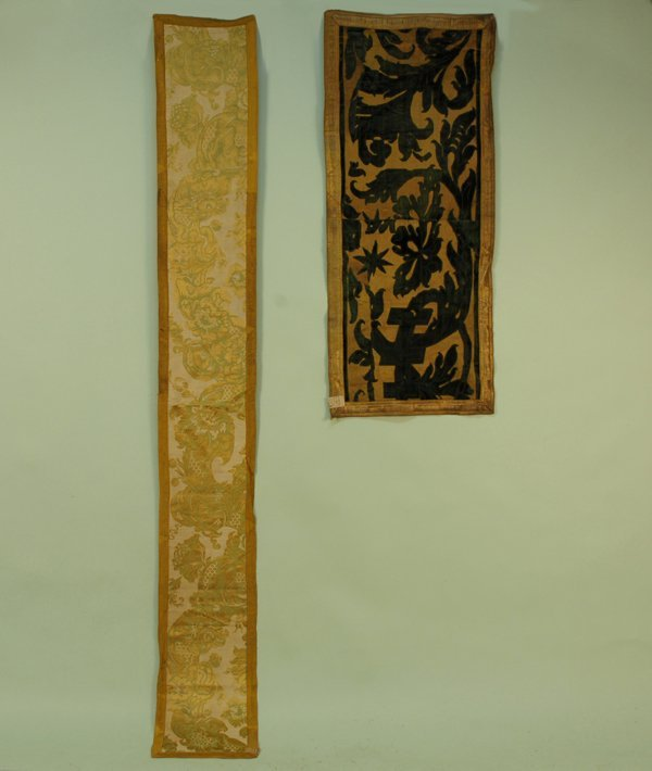 15: TWO SILK RUNNERS, 17th C. Pieced gold silk ground w