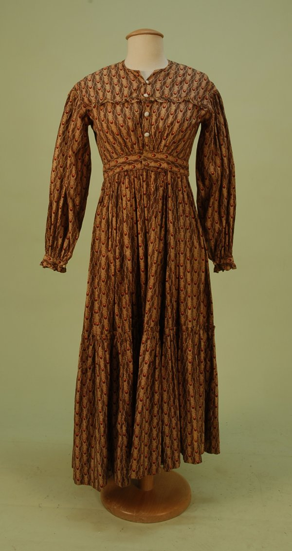 294: PRINTED COTTON DAY DRESS, 1830's. Red, black, brow