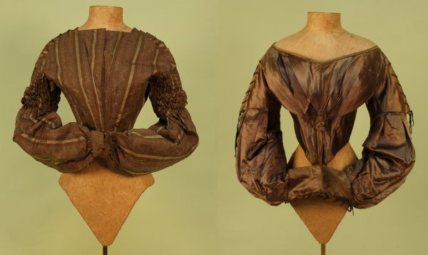 295: TWO SILK BODICES, 1830's. Both with pointed front,