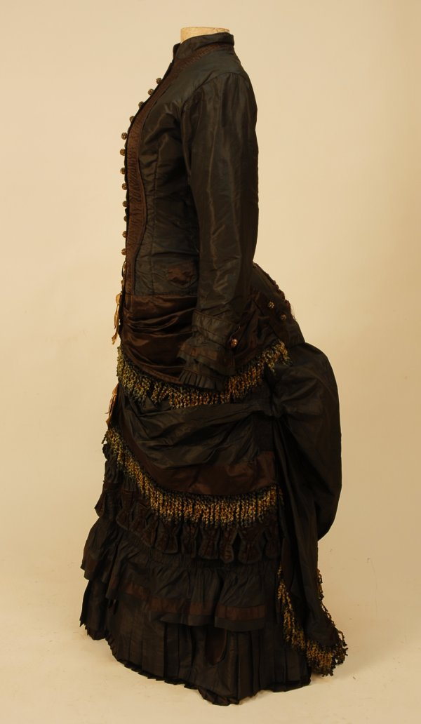 309: BLACK and BROWN SILK BUSTLE DRESS, 1880-1882. 2-pi