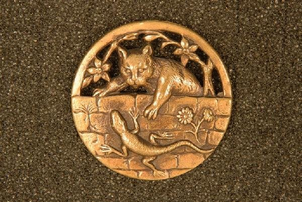 CAT WITH LIZARD BUTTON. Large stamped and pierced brass