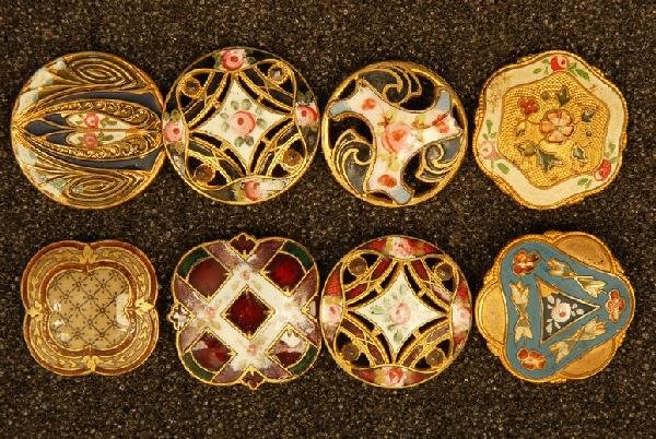EIGHT ENAMELED BRASS BUTTONS. All medium, including two