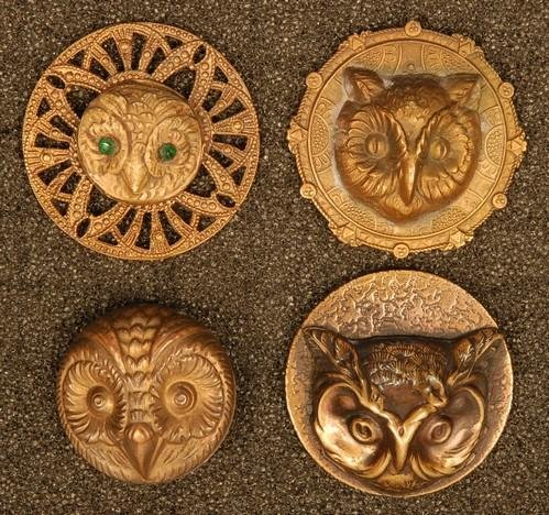 FOUR HIGH RELIEF OWL HEAD STAMPED BRASS BUTTONS. Three