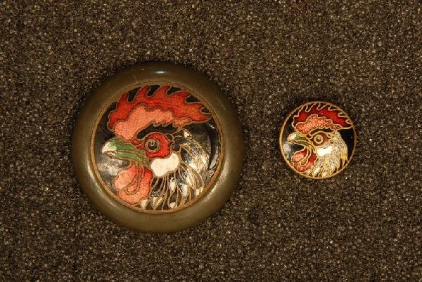 TWO CHAMPLEVE ENAMEL ON BRASS ROOSTER BUTTONS. One larg