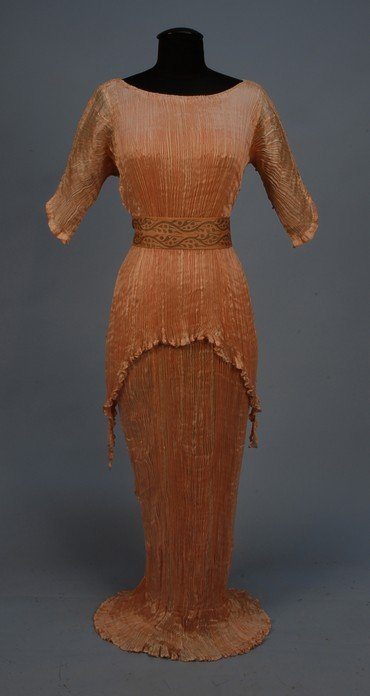 962: FORTUNY PEPLOS GOWN, c. 1920. Pink crinkled silk w