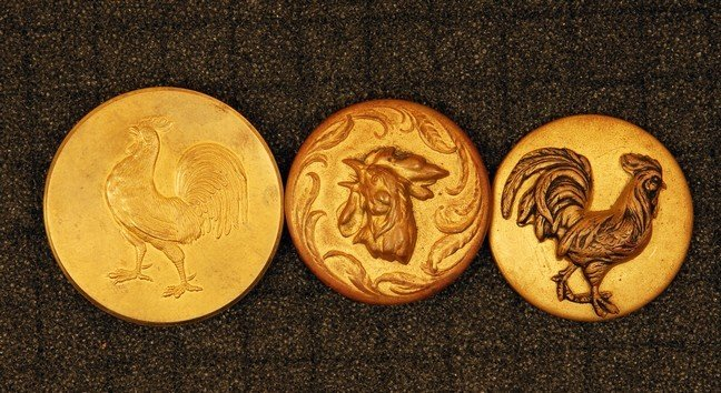 1: THREE ROOSTER BUTTONS. All large stamped brass: 2-pi
