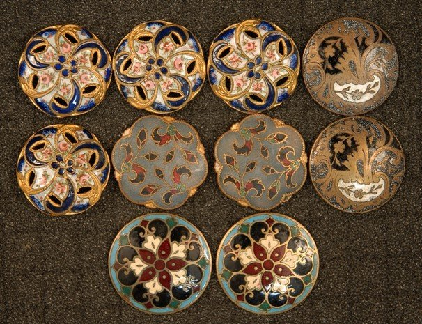 6: TEN ENAMELED BRASS BUTTONS. Medium and large 1-piece