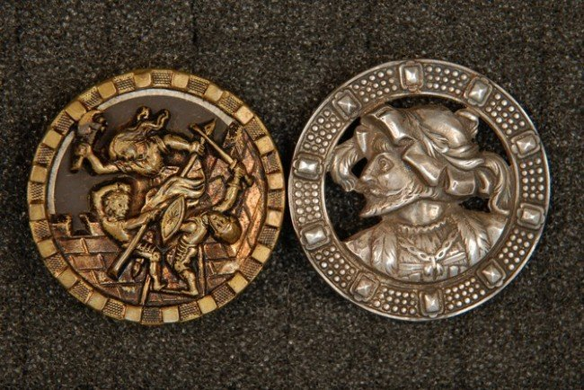 7: TWO FIGURAL STAMPED and PIERCED BRASS BUTTONS. Both