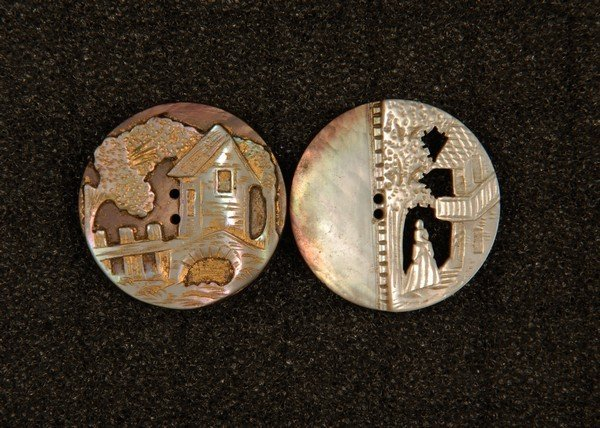 13: TWO CAMEO CARVED PEARL BUTTONS. Medium sew through:
