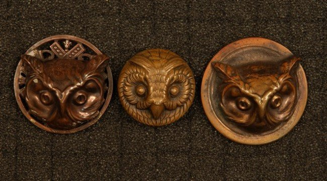 21: THREE HIGH RELIEF STAMPED BRASS OWL HEAD BUTTONS. O