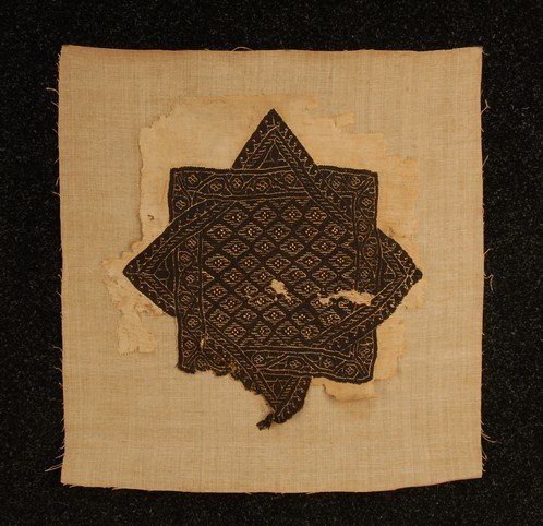 393: COPTIC STAR, 5th C. Wool tapestry weave on linen o