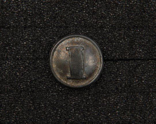 7: CONFEDERATE INFANTRY BUTTON. Medium white metal with