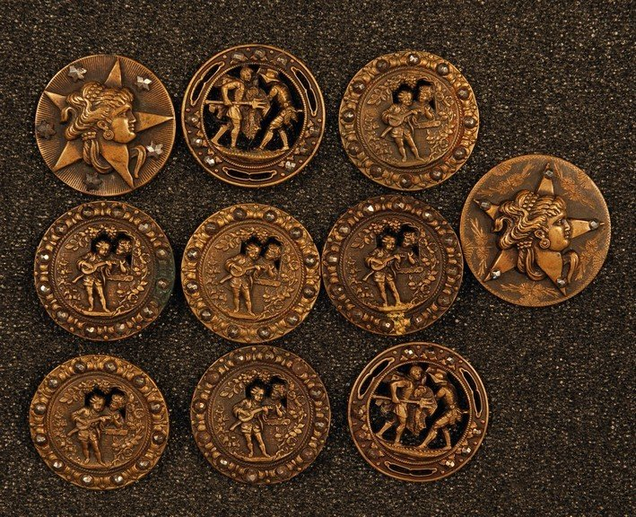 22: EIGHT LARGE PIERCED, STAMPED BRASS BUTTONS with CUT