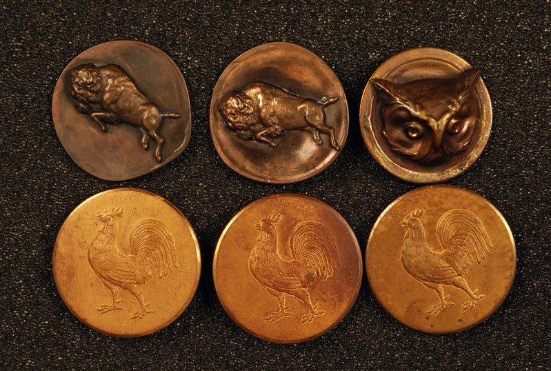 23: SIX LARGE BRASS BUTTONS with BIRDS and ANIMALS. Thr