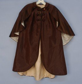 308: INFANT'S SILK CLOAK with ATTACHED CAPE, 1868. Brow