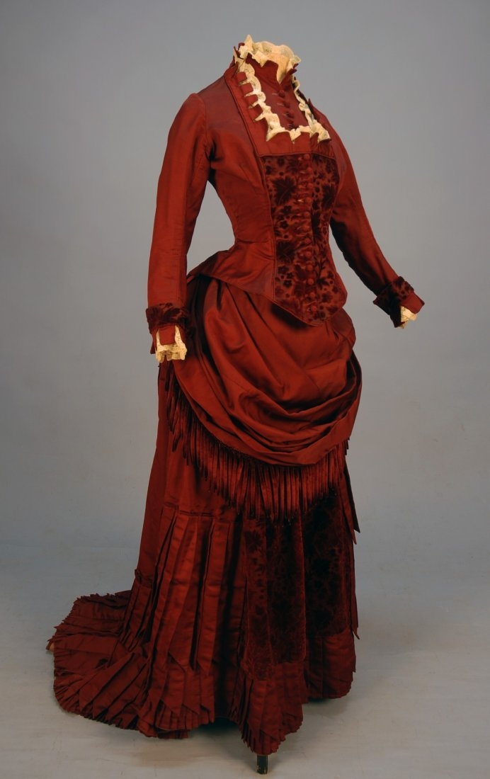 456: SILK and VELVET BUSTLE DRESS with FRINGE, c. 1880.