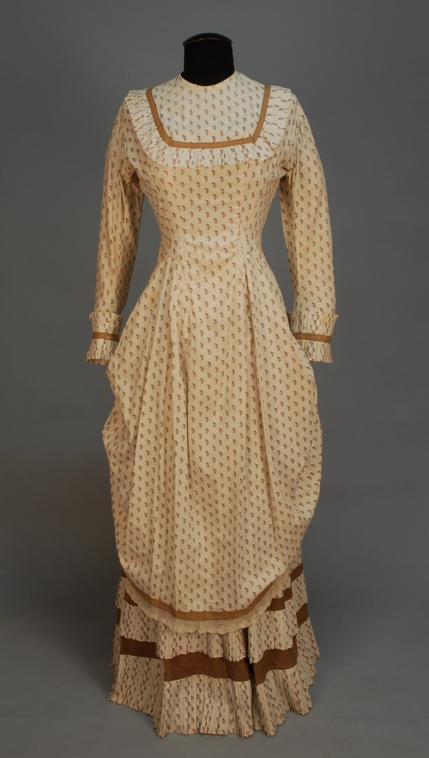 457: PRINTED COTTON POLONAISE DRESS, 1880's. Cream with
