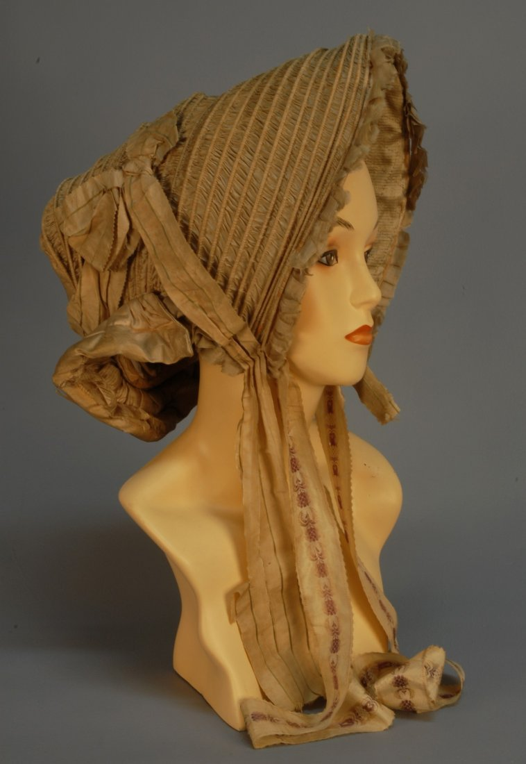 464: SILK DRAWN BONNET, c. 1810. Wheat colored satin wi