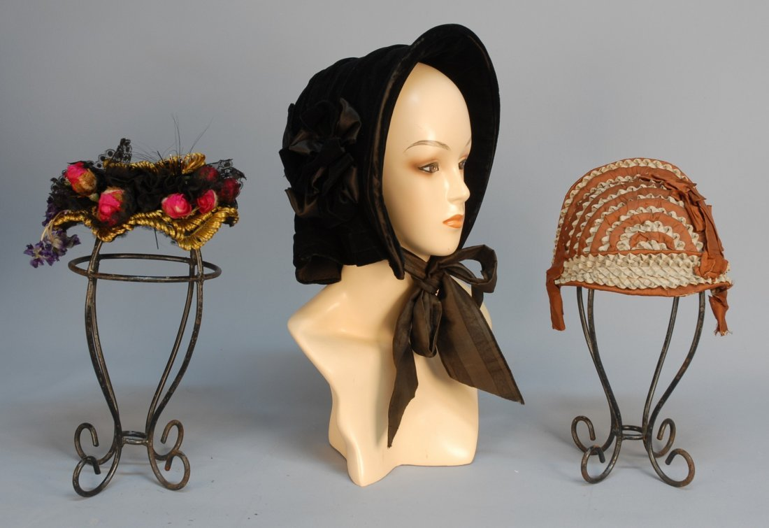 469: THREE BONNETS, 1840's-1880's. Black velvet with ba