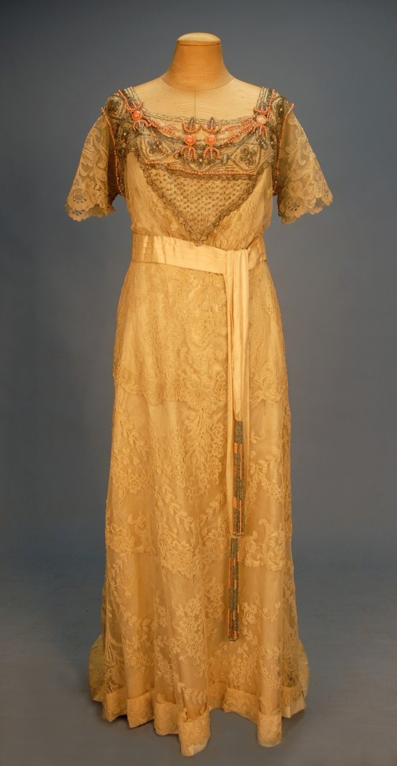 569: BEADED and TRAINED LACE GOWN, c. 1915. Cream flora