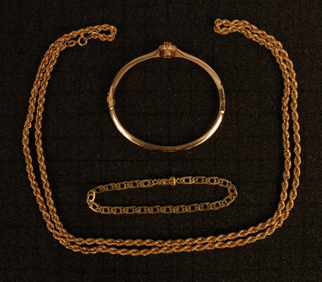 784: THREE PIECES 18K GOLD JEWELRY, 20th C. Consisting